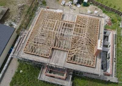 an aerial view of an extensive roof showing timber roof trusses, designed and supplied by ETE Ltd
