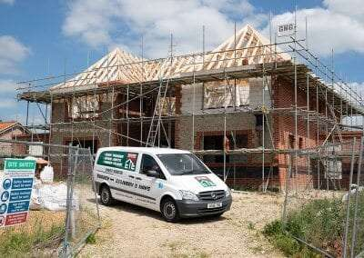 An ETE van on site in front of a new build home. Timber trusses designed and installed by ETE Ltd