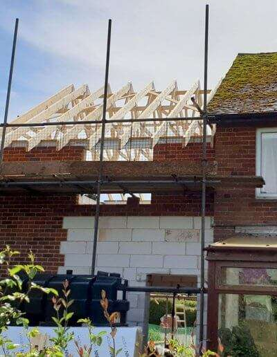 Bare roof trusses installed onto a side extension