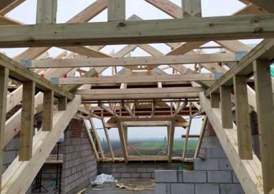 image shows the interior view of roof trusses supplied and installed by enviro timber engineering in downham market