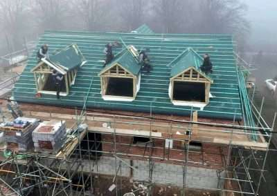 image shows workers installing roof trusses